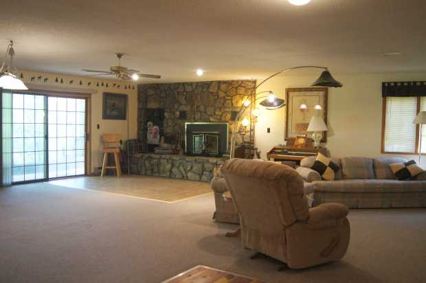 Fireplace and living area in cabin, Caro Drive